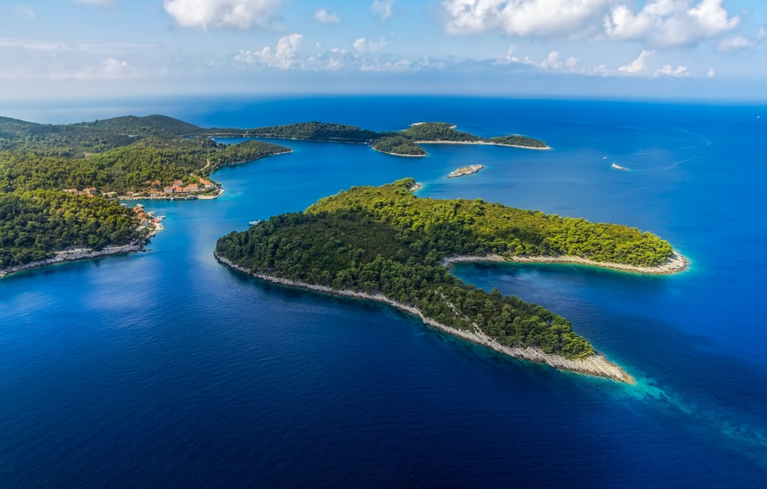 'Aerial helicopter shoot of National park on island Mljet, village Pomena, Dubrovnik archipelago, Croatia. The oldest pine forest in Europe preserved.' - Dubrownik